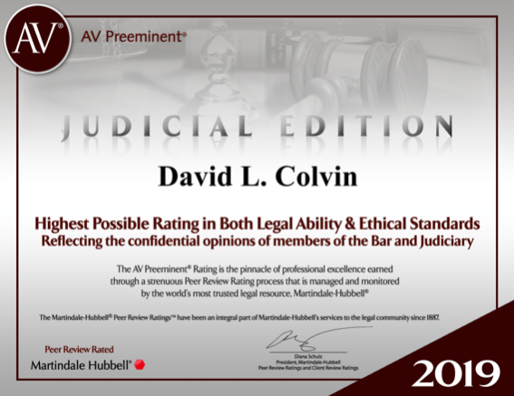 David L. Colvin accepting a plaque for service as the President of the Jefferson Bar Association.